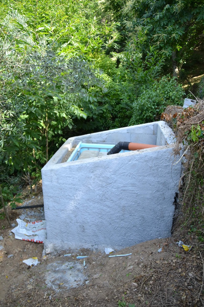 The IBC tank for the vermicomposting system surrounded by insulation (polystyrene sheeting and leca - lightweight expanded clay aggregate) within a blockwork container