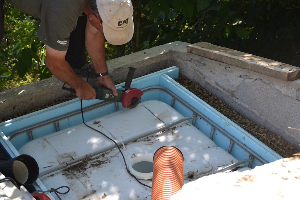 Cutting an access hatch into the top of the IBC tank